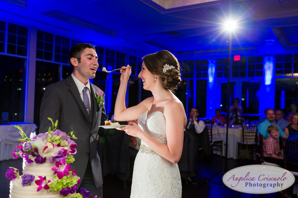 Fun reception photos at stone bridge golf club in smith town, long island new york cake cutting