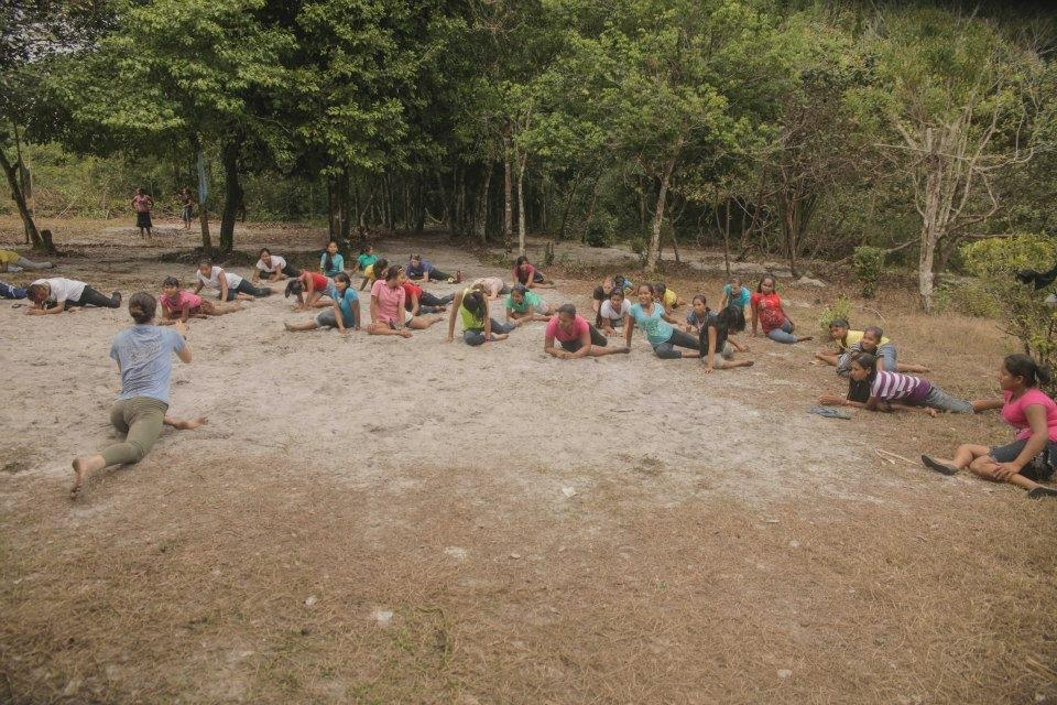 Daphne teaching yoga in the jungle of Guyana.