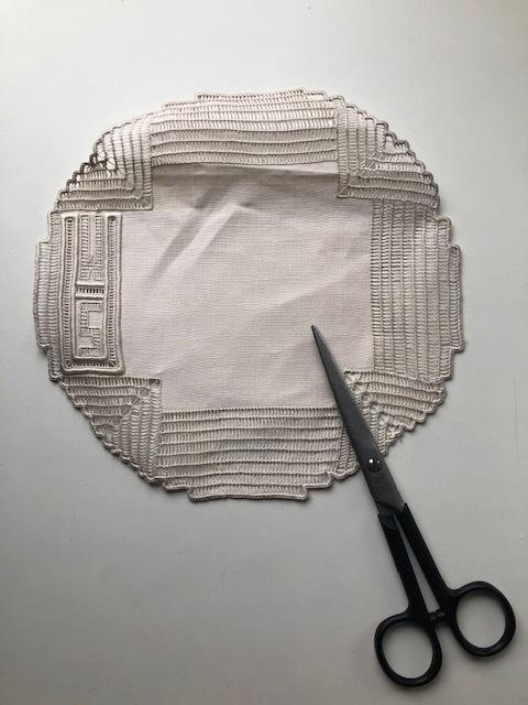 Simply take a vintage napkin or linen coaster.