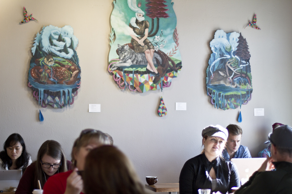 Inside Sunrise Coffee with artwork from local artist Su Limbert.