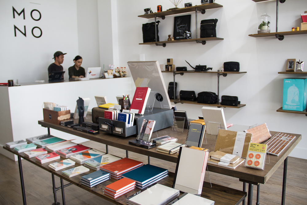 A thoughtfully curated selection of design-driven goods at Mōno. Owners Dean & Cassy Song are in the background manning the counter.