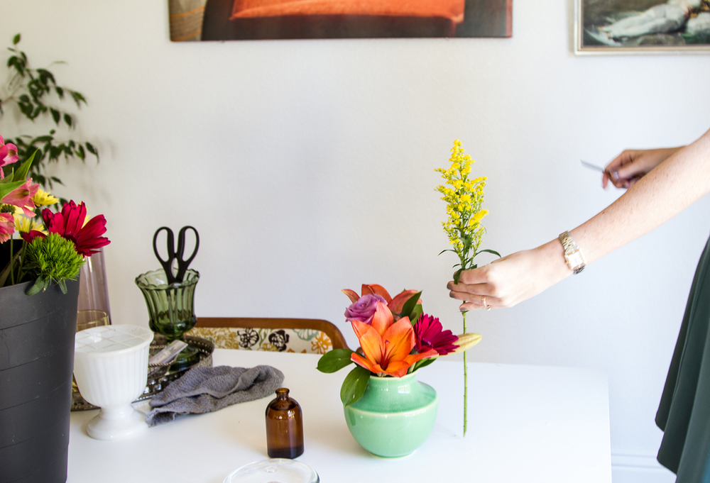 Hold up your stem against the vase to get a gauge on where to trim for the right height.