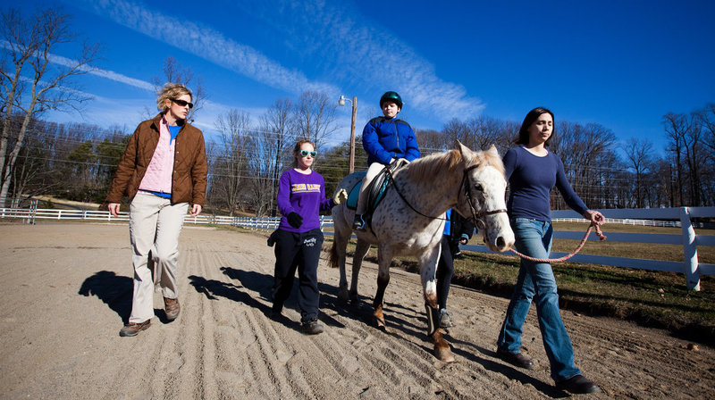 Ryan Shank-Rowe, 9, takes part in a therapeutic riding program at Little Full Cry Farm in Clifton, Va., last month.   Maggie Starbard/NPR Heard on  Morning Edition   JULIE ROVNER