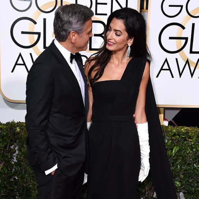 Our votes are in: The true winner of last nights #GoldenGlobes is #AmalClooney!  Not only are we loving her black #Dior gown (even the gloves!) and her gorgeous arm candy, but we applaud HER lifetime achievements as noted by #TinaFey.  The perfect mix of #beauty, #brains, and a heart of gold.  To find out more about Amal and her career/fashion, head over to our blog (link in the bio!!👆👆👆)