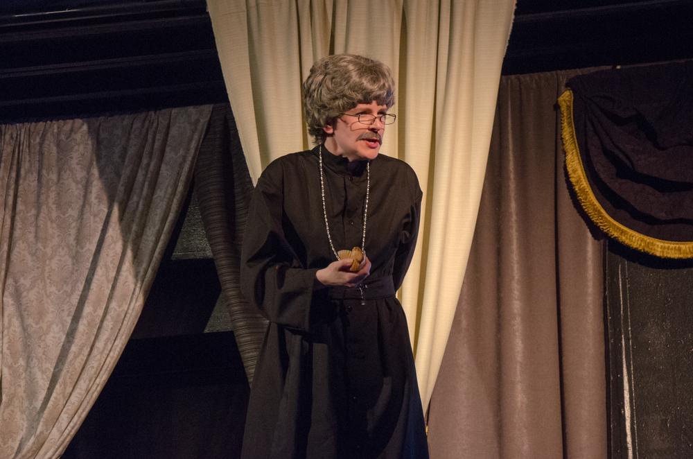 Father Jorgensen (Kathryn Miller)