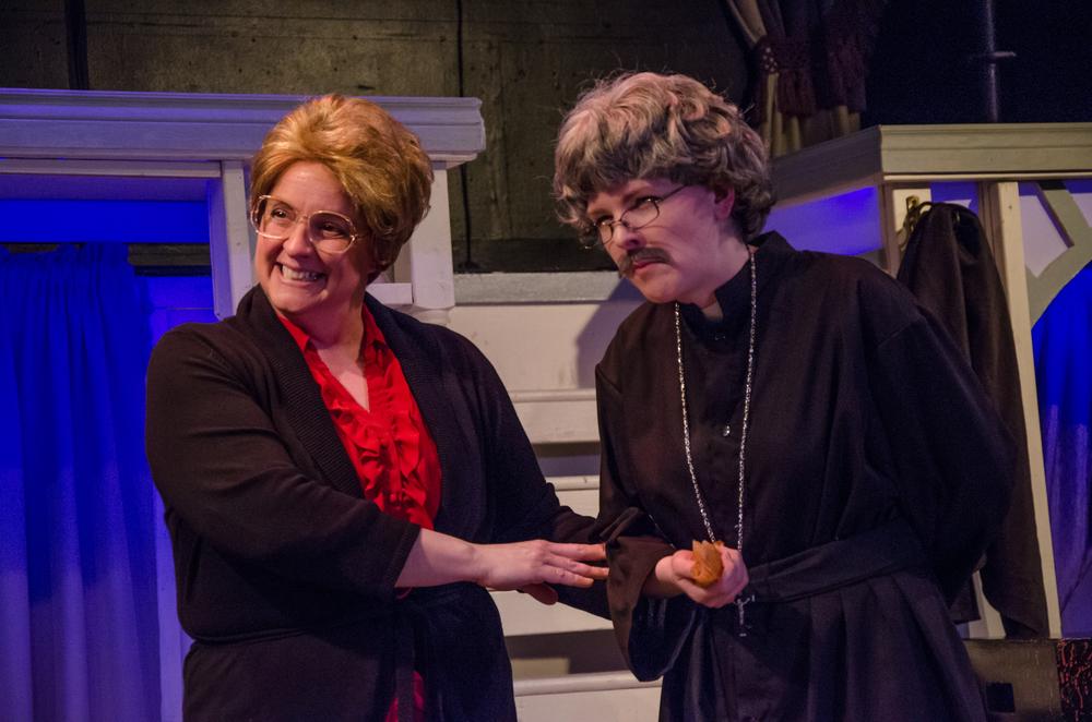 Minnesota Mother (Melissa Himmelreich Nicholson), Father Jorgensen (Kathryn Miller)