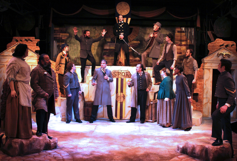 Front: Citizen (Chelsea Day), Sicinius (Dan Burke), Soldier (Brennan Watt), Senator (Charles Hooker), Brutus (Jeffrey Rensch), Citizen (Erin Eckert), Citizen (Kennedy Miller), Soldier (Chris Marth)  Back: Citizen (Rose Weber), Cominius (Mark Sherlock), Coriolanus (Thomas Weaver), Menenius (Philip Wheeler), Citizen (Aidan Roth), Citizen (Collin Wilmarth)