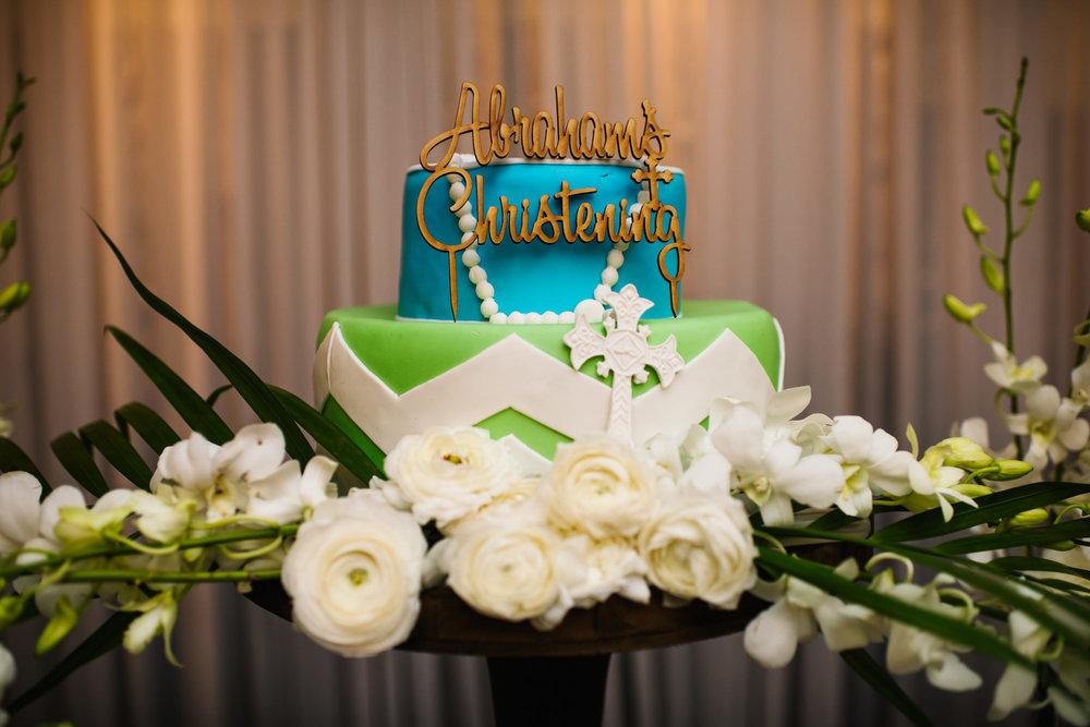 Blue green gold christening cake