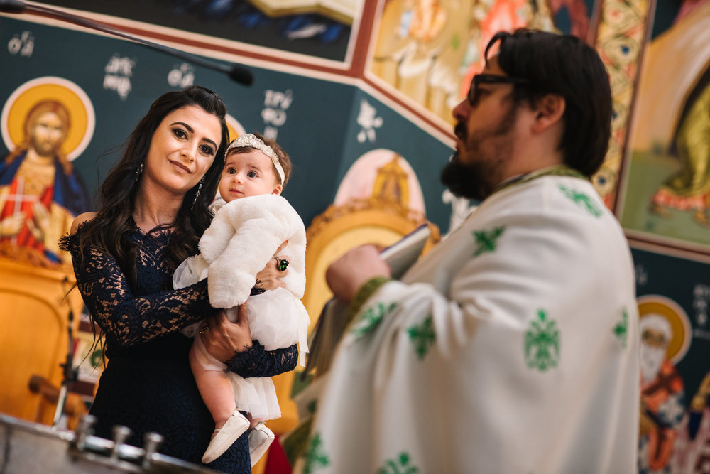 Godmother and baby Greek Orthodox christening