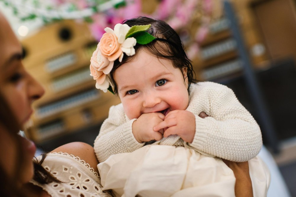 Baby smiling at Oliveto christening venue
