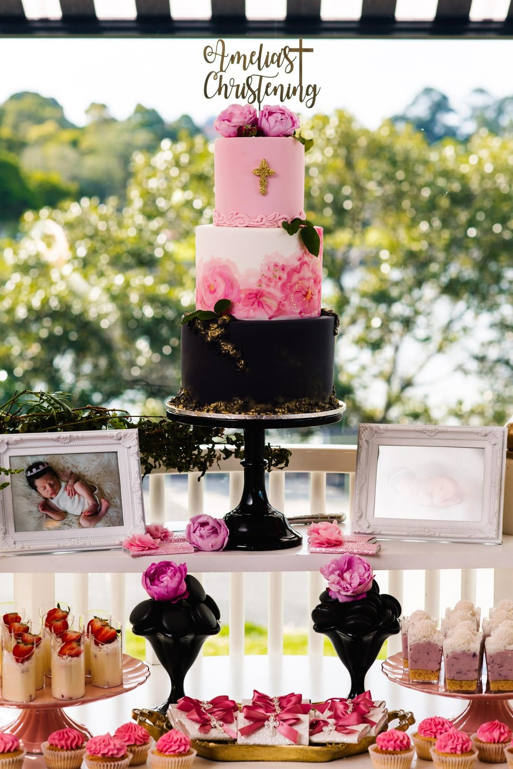 Pink, black and white christening cake at Oliveto Sydney