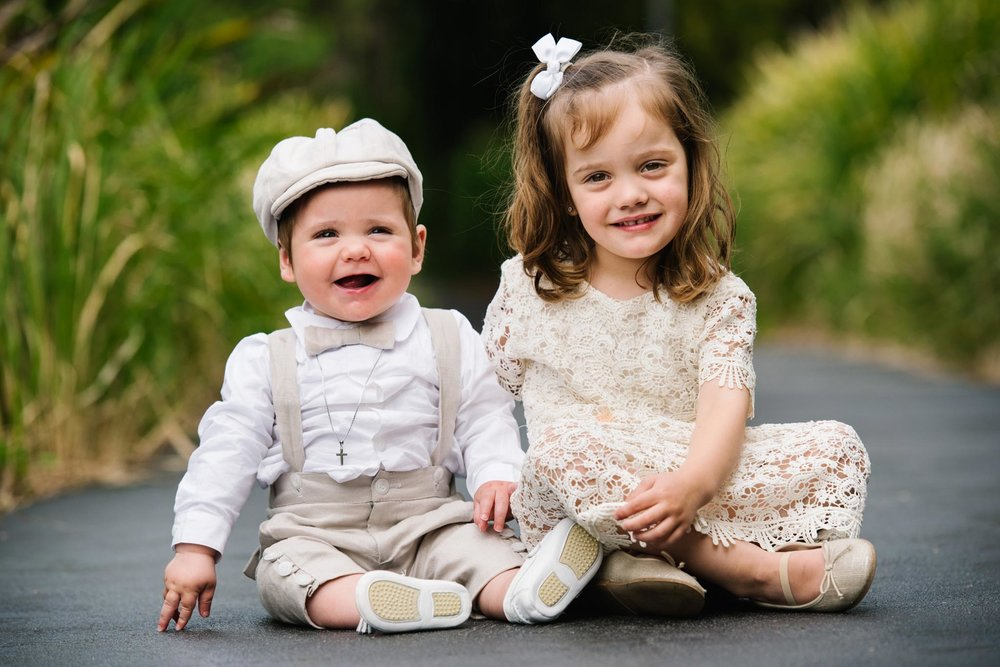 Cute brother and sister at christening venue Oliveto in Sydney