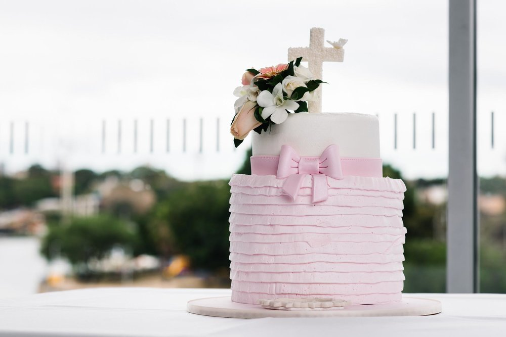 Pink frilly christening cake at Ecco Ristorante