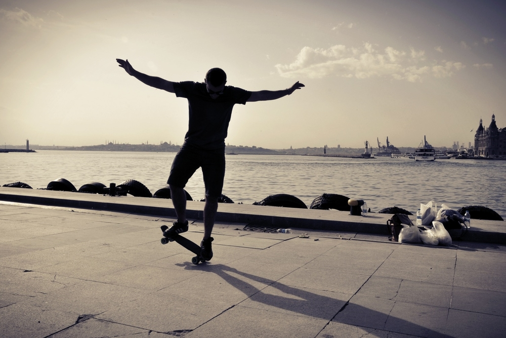 Skateboarding in front of the Bosphorus River in Istanbul, Turkey.  More photos and stories from Turkey can be found here.