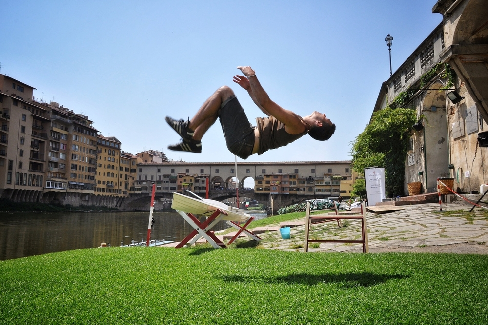 Backflip in front of the Ponte Vecchio in Florence, Italy.  More photos and stories from Italy can be found here.