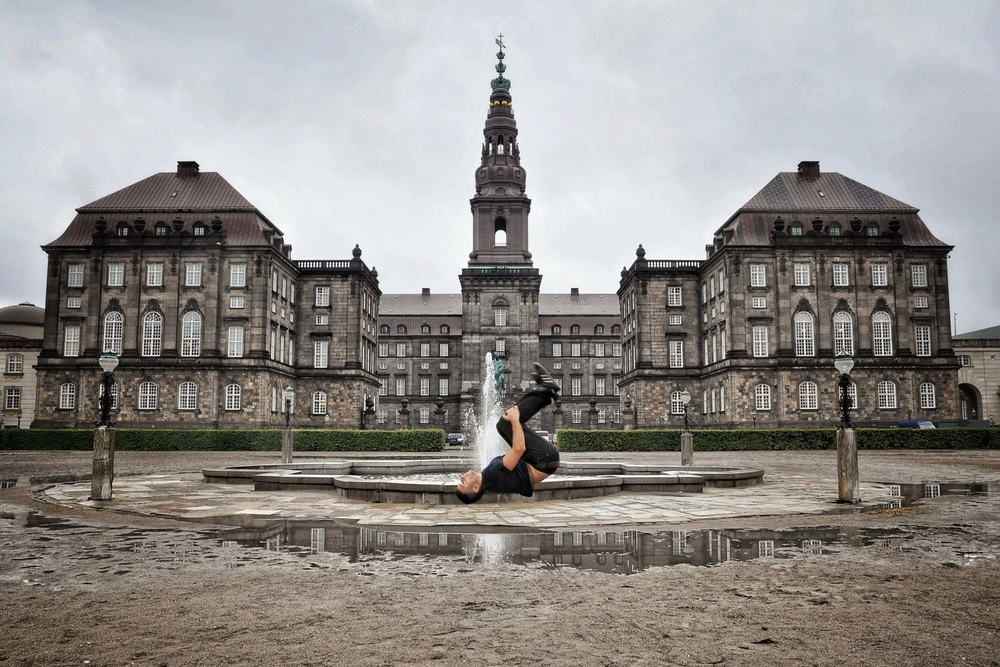 Backflip in front of Christiansborg Palace in Copenhagen, Denmark.  More photos and stories from Denmark can be found here.