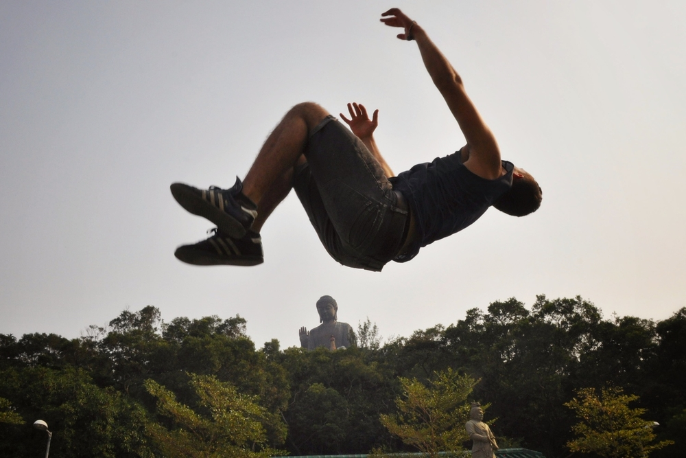 Backflip in front of the Buddha, Hong Kong.  More photos and stories from Hong Kong can be found here.