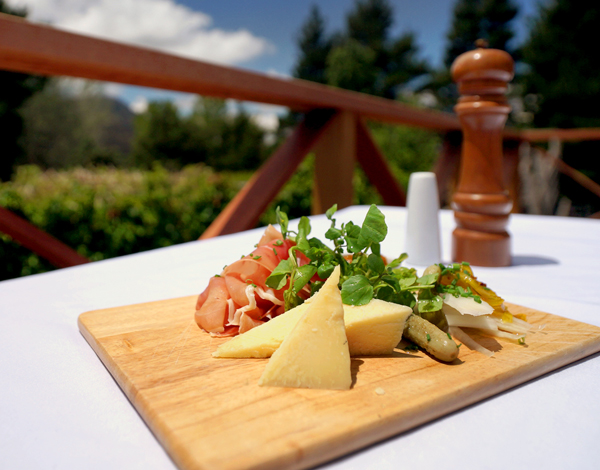 Cheese platter served in the garden at Crackenback Farm