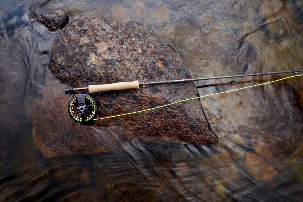 Fishing rod rests on rock in Thredbo River