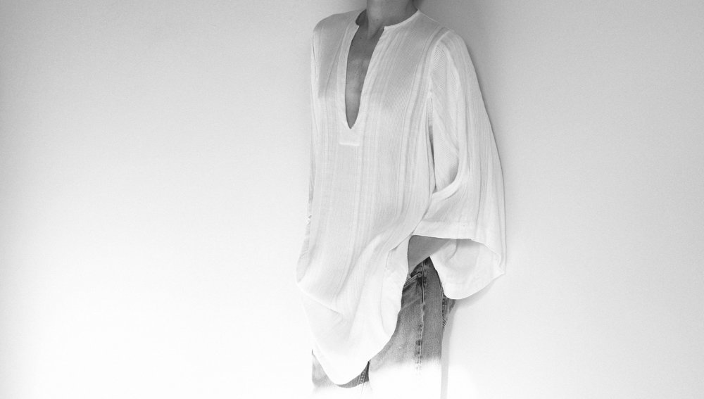Sebastien wears the Sunday Caftan Short in Creme