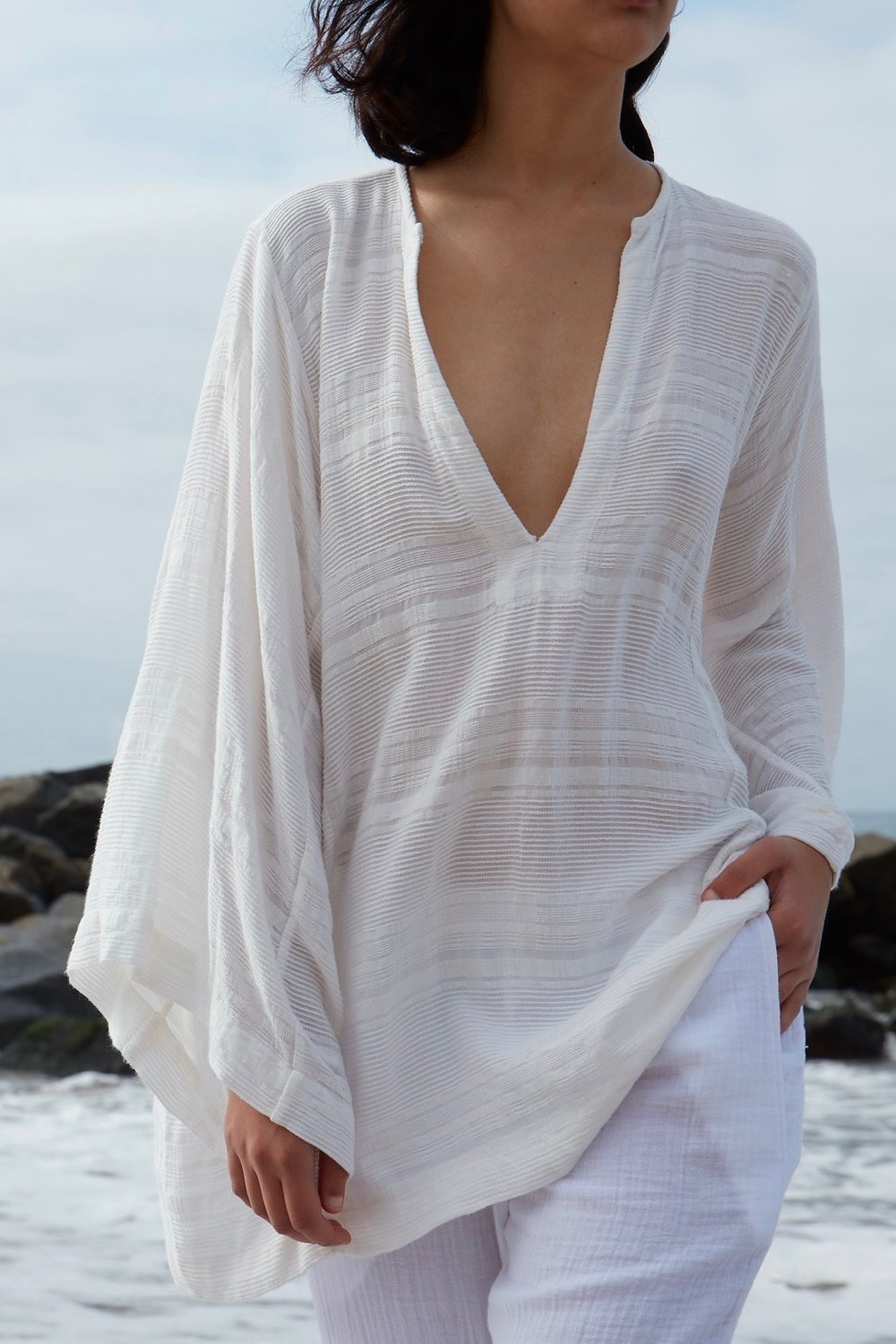 Perwana wears the  Sunday Caftan Short  in Creme and the gauze  Resort Pant.