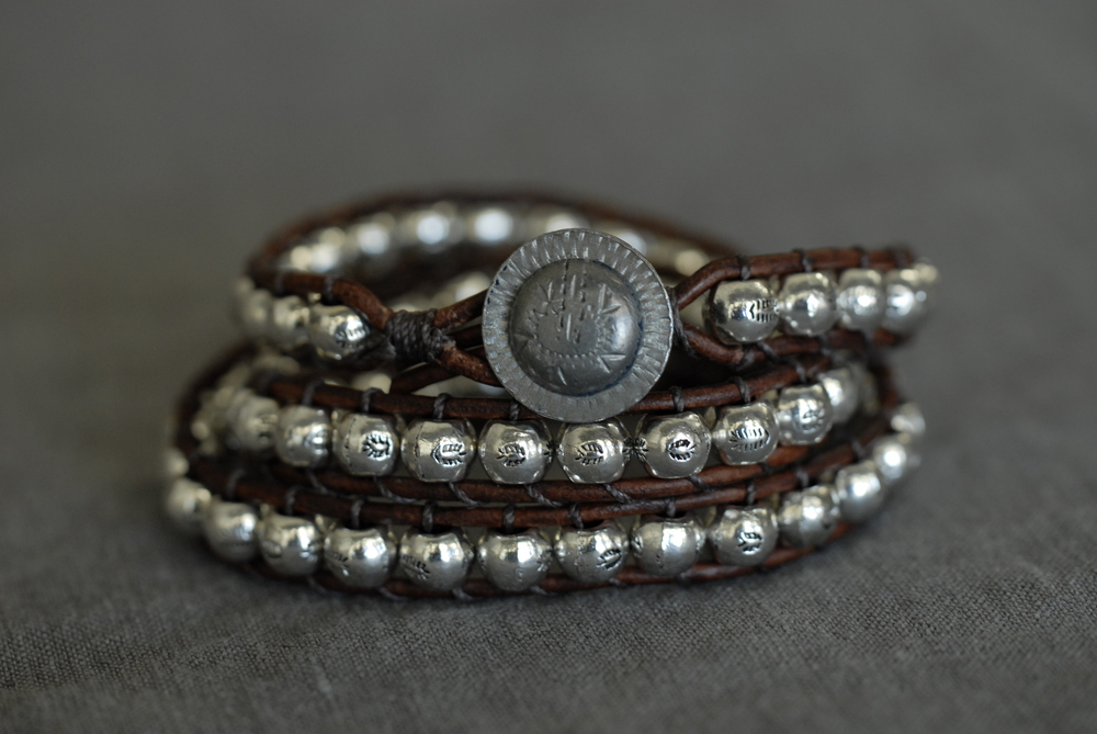Triple wrap bracelet with medium brown leather and large pewter bead, unique button
