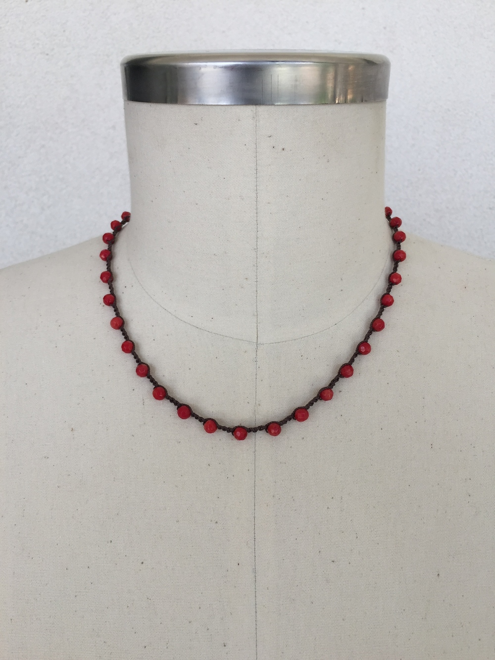 "4mm Faceted Red Coral on Chocolate - shown here in 19"" length"