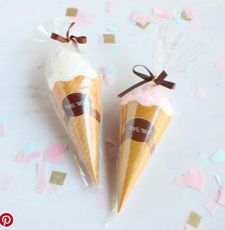 Adorable  ice cream cones  with a surprise inside for guests to take home as favor.