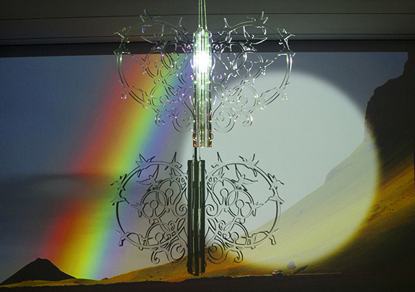 Hummingbird Rainbowmaker 2016 video projection, rotating clear acrylic glass sculpture, suspended from ceiling projector, media player, and speaker 36 x 36 x 23 in / 92 x 92 x 60 cm