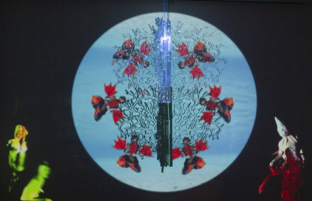 Coral Rainbowmaker 2016 video projection, rotating clear acrylic glass sculpture, suspended from ceiling projector, media player, and speaker 36 x 36 x 23 in / 92 x 92 x 60 cm