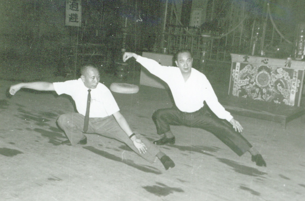 Master Gim Shek Ju practicing Tai Chi on the right.  Mamie's father, Master Gim Shek Ju is on the honor roll at the American Association of Oriental Medicine as one of the founding fathers of TCM in the United States.