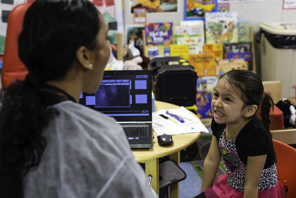 Dental hygienist Mireya Rodriguez conducts an initial screening on Ammi Alvarez, 4, at Silva Head Start in Los Angeles as part of a pilot program to increase oral health awareness, offer preventive care and provide children early access to treatment.