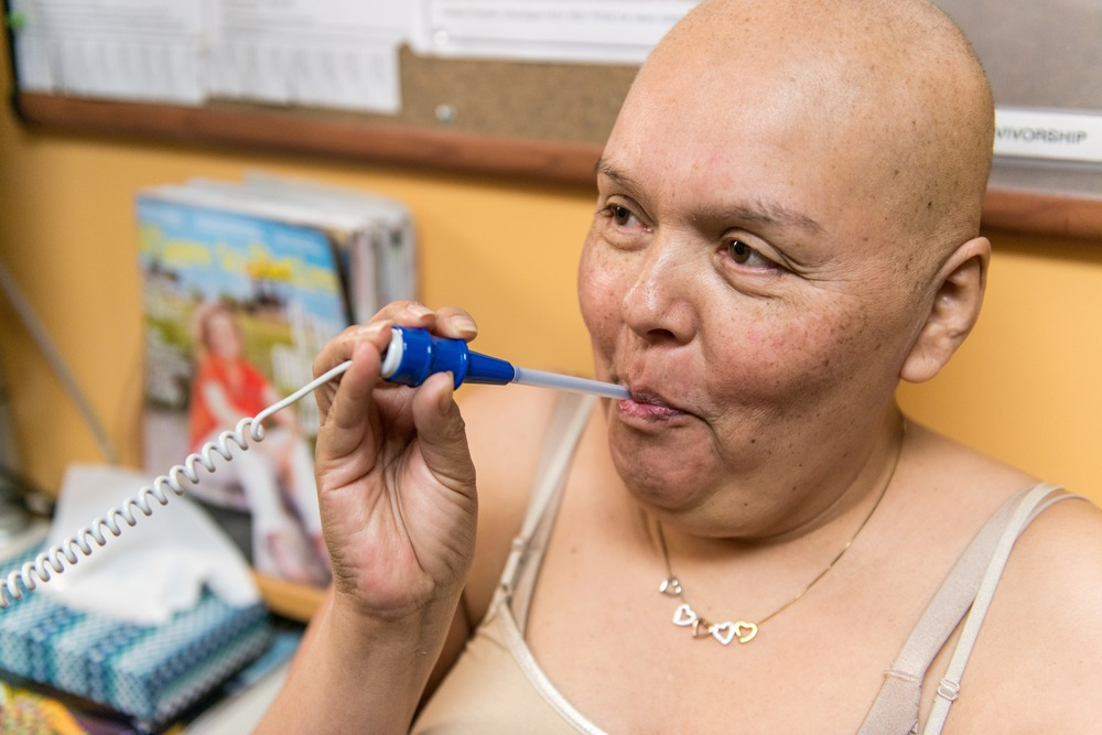 Rose Gutierrez, 52, gets her vitals taken at UC San Francisco on Wednesday, February 11, 2015. The caregiver from Merced was diagnosed with cancer last spring after a mammogram and needs to make a decision about further treatment