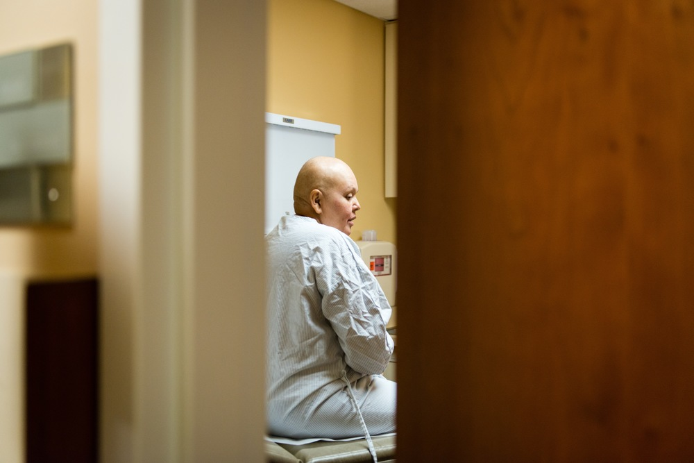 Gutierrez waits to be examined by plastic surgeon Robert Foster and Dr. Jasmine Wong. Gutierrez recently had a lumpectomy and underwent 10 weeks of chemotherapy, but the cancer is still present