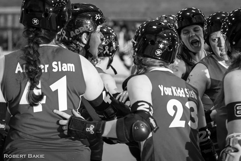 ACRD celebrates a win against the Bellingham Roller Betty's Cog Blockers in 2015.