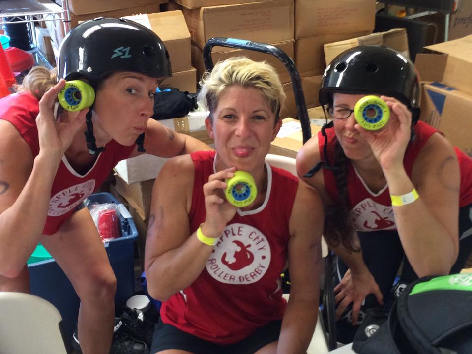 ACRD's Washington State Roller Derby conference MVPS!  Left to right: Runt #6, Mann #22, Rumble Bee Marie #75