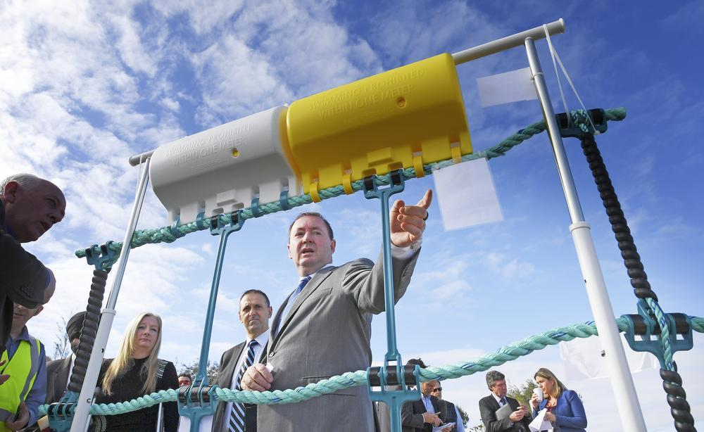 Fisheries Minister Joe Francis alongside Global Marine Enclosures' Aquarius Barrier sample.