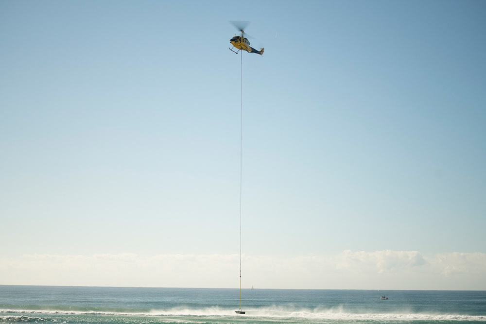 Helicopter lifts Aquarius Barrier at Lennox Head