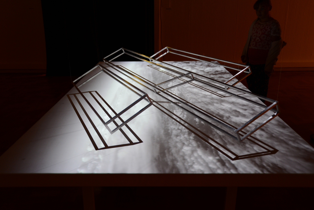 Air-toAir (Pitched Formation), 2015, aluminium frames, screen and moving image projection.  Installation view.