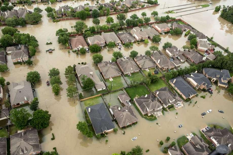 Flooded Houston homeowners await a poorly-timed legislative deadline. Photo credit:Brett Coomer, Houston Chronicle.