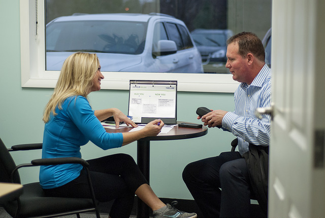 Julie meets with a new client to assess their fitness goals.