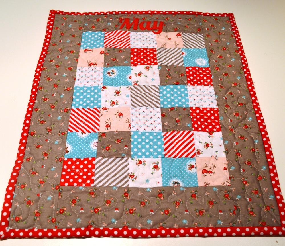 Dolls Quilt with heart quilting