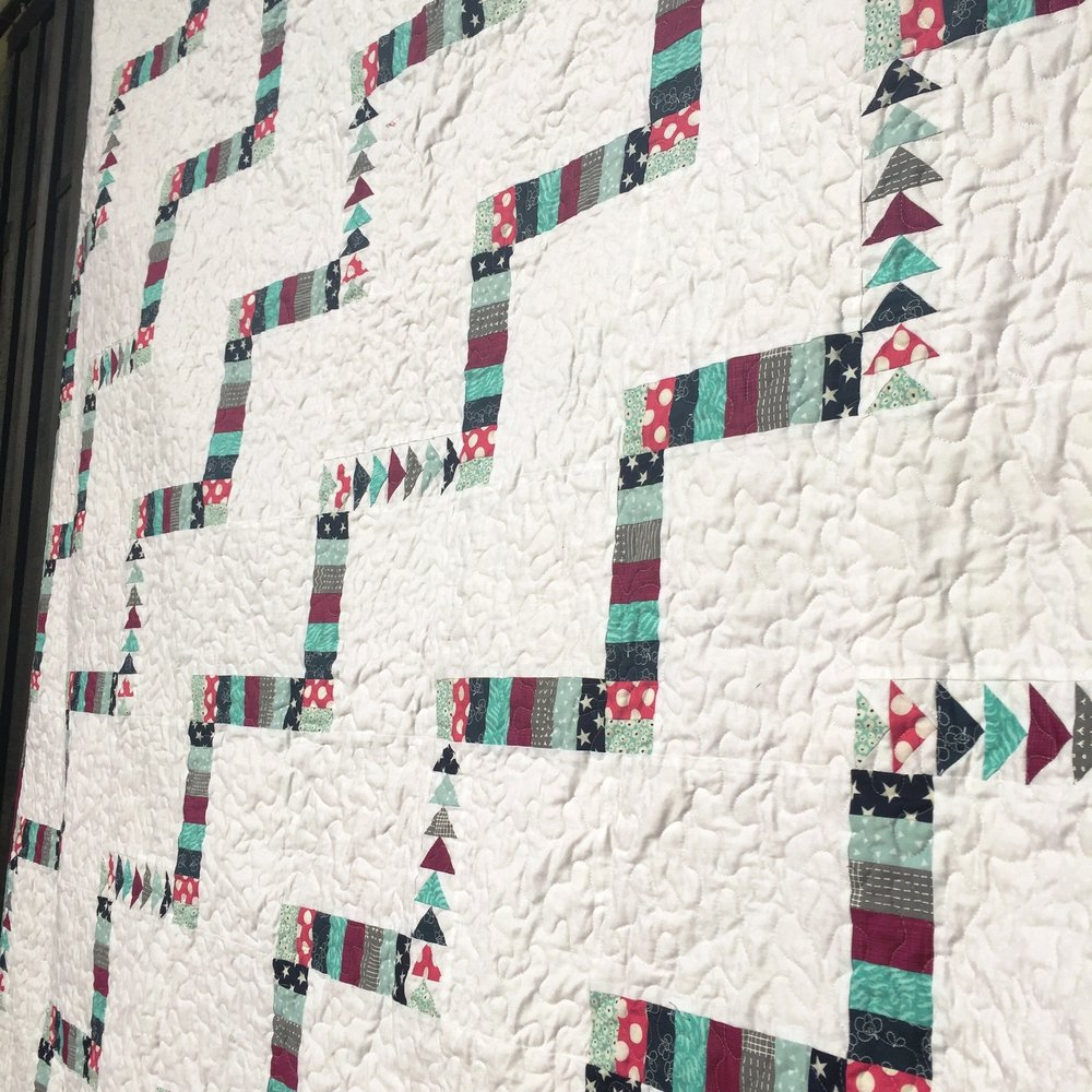 The Crafty Nomad Apples and Pears Quilt Design - a quilt pattern perfect for beginners and those progressing onto tougher blocks.  It has simple options or a more advanced option with flying geese (pictured)  Be sure to click to find out more