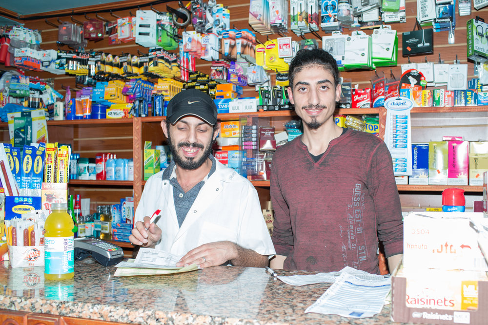 Amer Ali, 45 and Abdulla Yaface, 25 at Quick Stop Deli & Grocery off the Montrose Avenue Station in East Williamsburg. Photographed for a story on how the shutdown will impact bodegas located next to train stops.