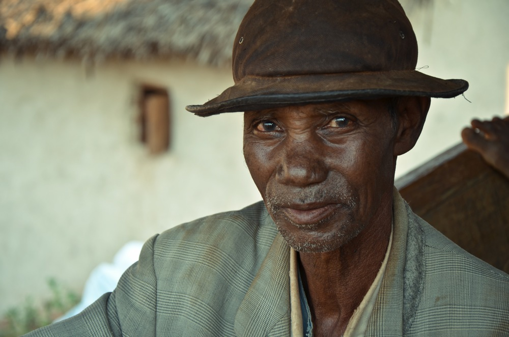A farmer in northeastern Madagascar with several lavaka on his land. Photo: Alizé Carrère