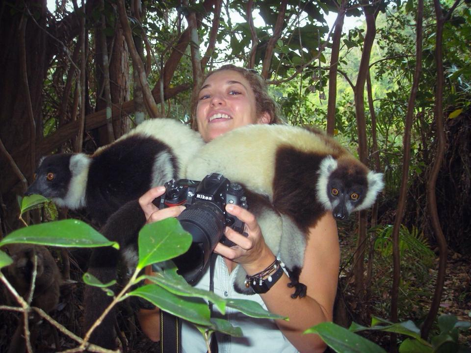 When photo subjects find it more exciting to be behind the lens...! Black-and-white ruffed lemurs in Madagascar.