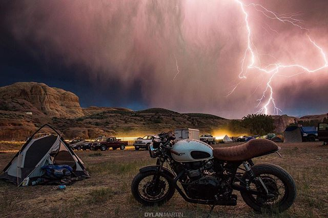 An epic photo by @dylmarphoto of the storm that passed through @motosinmoab with @thericheproject's Triumph Thruxton in the forefront. Thanks for sharing! . #croig #caferacersofinstagram