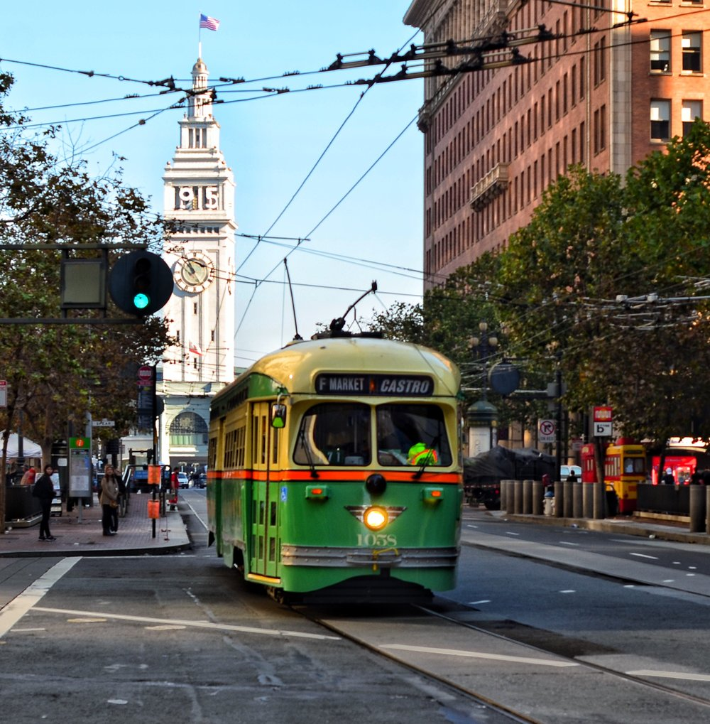 Cable Car on Market Street with the iconic San Francisco Ferry Tower in the background