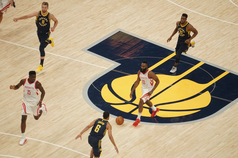 James Harden #13 dribbles up the court.