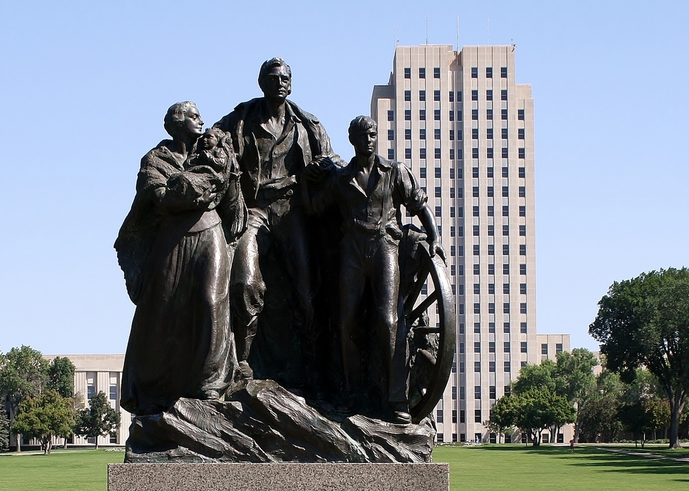 The PIONEER FAMILY statue greets visitors at the front entrance of our capitol grounds.